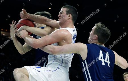 Marshall Plumlee, Nick Victor, Sam Downey Duke's Marshall Plumlee, center, battles Yale's Nick Victor, left, and Sam Downey (44) for a rebound during the second half in the second round of the NCAA men's college basketball tournament in Providence, R.I., . Duke won 71-64