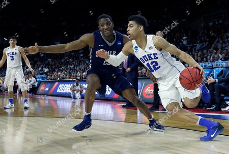 Derryck Thornton, Justin Sears Duke's Derryck Thornton (12) drives past Yale's Justin Sears (22) during the second half in the second round of the NCAA men's college basketball tournament in Providence, R.I., . Duke won 71-64