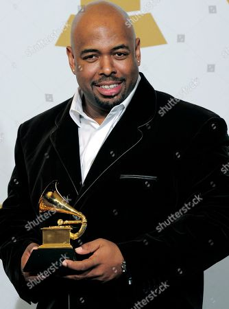 """Christian McBride Christian McBride, of the Christian McBride Big Band, poses backstage with the award for best large jazz ensemble for """"The Good Feeling"""" at the 54th annual Grammy Awards in Los Angeles. The Newport Festivals Foundation announced, that McBride has been named artistic director of the Newport Jazz Festival. McBride will work side-by-side with George Wein at the Rhode Island festival in 2016, and take the reins for the 2017 festival"""