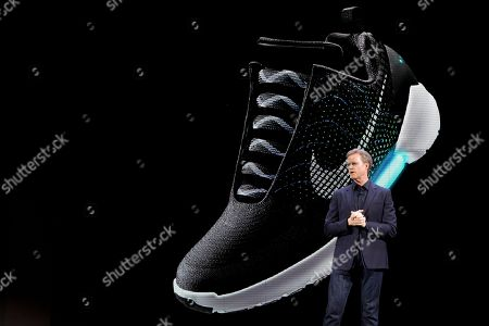 Mark Parker An image of the Nike HyperAdapt 1.0 is projected on a screen as Nike CEO Mark Parker speaks during a news conference, in New York