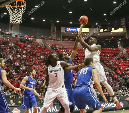 Zylan Cheatham, Max Landis, Brent Calhoun San Diego State forward Zylan Cheatham scores on a jump shot from the top of the lane over IPFW's Max Landis, right, and Brent Calhoun durng the second half of an NIT opening-round college basketball game, in San Diego