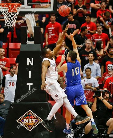 Max Landis, D'Erryl Williams IPFW guard Max Landis scores over San Diego State guard D'Erryl Williams during the second half of an NIT opening-round NCAA college basketball game, in San Diego