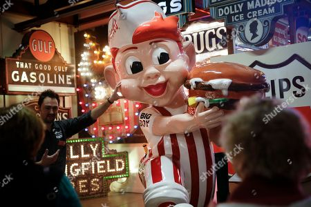 Kevin Wallace touches the face of a Big Boy mascot at the American Sign Museum, in Cincinnati. The mascot, with it's red hair and striped attire, is a rare example of the classic American fast food franchise. The museum favors signs that possess a uniqueness in addition to their cultural significance