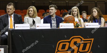 Stock Image of Brad Underwood, Susan Underwood, Tyler Underwood, Katie Underwood, Ashley Underwood Brad Underwood, left, is pictured with his family at a news conference to announce his appointment as the new Oklahoma State NCAA college basketball coach in Stillwater, Okla., . From left: Brad Underwood, his wife Susan Underwood, their son Tyler Underwood, their daughter Katie Underwood and their daughter Ashley Underwood