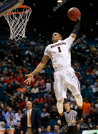 Oregon State guard Gary Payton II dunks against Arizona State during the second half of an NCAA college basketball game in the first round of the Pac-12 men's tournament, in Las Vegas