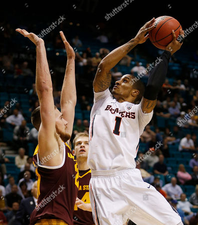 Oregon State guard Gary Payton II shoots over Arizona State forward Eric Jacobsen during the second half of an NCAA college basketball game in the first round of the Pac-12 men's tournament, in Las Vegas