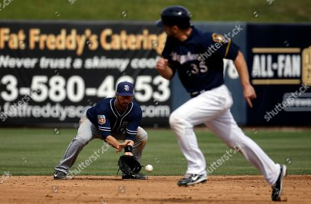 San Diego Padres' Nick Noonan makes a play during the second inning of a spring training baseball game against the Milwaukee Brewers, in Phoenix