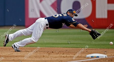 Milwaukee Brewers' Shane Peterson can't catch a double hit by San Diego Padres' Nick Noonan during the second inning of a spring training baseball game, in Phoenix