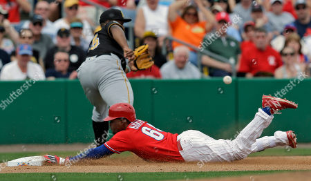 Cedric Hunter, Jason Rogers Philadelphia Phillies' Cedric Hunter, bottom, slides into third base with a triple as the ball skips away from Pittsburgh Pirates third baseman Jason Rogers during the second inning of a spring training baseball game, in Clearwater, Fla