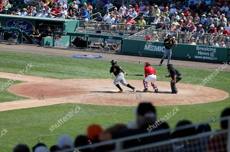 Jason Rogers Pittsburgh Pirates' Jason Rogers, center, follows through on a single to left off pitch from Boston Red Sox's Brian Johnson (not shown) in the sixth inning of an interleague spring training baseball game, in Fort Myers, Fla