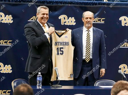 Stock Picture of Kevin Stallings, Scott Barnes Kevin Stallings, right, gets a team jersey from Pittsburgh athletic director Scott Barnes, during his introductory news conference as the new head coach for the Pittsburgh basketball team, in Pittsburgh