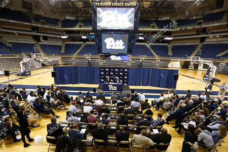 Stock Photo of Kevin Stallings, Scott Barnes Kevin Stallings, right, sits with athletic director Scott Barnes as he speaks at an introductory news conference as the new head coach for the Pittsburgh basketball team, on the court at the Petersen vents Center on campus in Pittsburgh