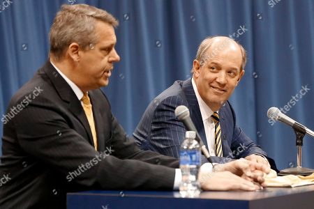 Stock Image of Kevin Stallings, Scott Barnes Kevin Stallings, right, listens as athletic director Scott Barnes answers a question speaks at an introductory news conference for Stallings as the new head coach for the Pittsburgh basketball team, in Pittsburgh