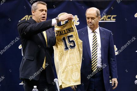Kevin Stallings, Scott Barnes Kevin Stallings, right, gets a team jersey from Pittsburgh athletic director Scott Barnes, during his introductory news conference as the new head coach for the Pittsburgh basketball team, in Pittsburgh