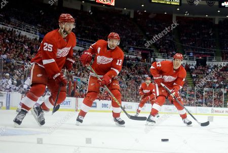 Mike Green, Pavel Datsyuk, Brad Richards Detroit Red Wings defenseman Mike Green (25), and centers Pavel Datsyuk (13) and Brad Richards (17) watch the puck during the second period of an NHL hockey game against the New York Rangers, in Detroit