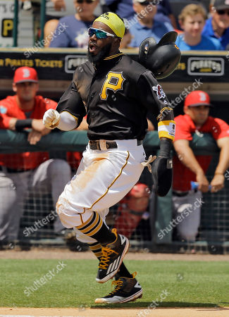 Josh Harrison, Ryan Hanigan Pittsburgh Pirates' Josh Harrison reaches home to score on an RBI single by Jason Rogers during the first inning of a spring training baseball game against the Boston Red Sox, in Bradenton, Fla