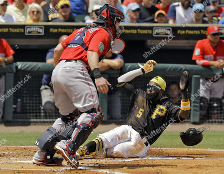 Josh Harrison, Ryan Hanigan Pittsburgh Pirates' Josh Harrison, right, scores in front of Boston Red Sox catcher Ryan Hanigan on an RBI single by Jason Rogers during the first inning of a spring training baseball game, in Bradenton, Fla