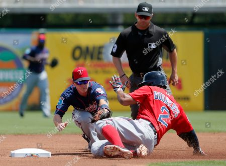 James Beresford, Xander Bogaerts, Will Little Boston Red Sox's Xander Bogaerts slides into second safely on a double under the attempted tag by Minnesota Twins' James Beresford, left, as umpire Will Little watches in the first inning of a spring training baseball game, in Fort Myers, Fla