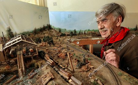 Charlie Edwards On, Charles Edwards looks over his model train layout in Alameda, Calif. Edwards, a retired city gardener will be knocking on doors in Alameda to persuade voters to support a citizen initiative to cap rent increases