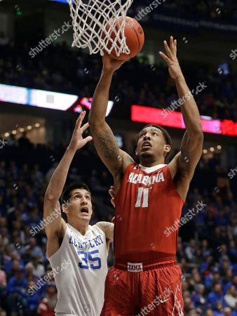 Shannon Hale, Derek Willis Alabama's Shannon Hale (11) shoots past Kentucky's Derek Willis (35) during the first half of an NCAA college basketball game in the Southeastern Conference tournament in Nashville, Tenn