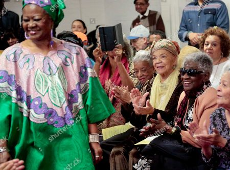"""Kris Allen, left, receives applause from seniors crowd as she model during the Carter Burden/Leonard Covello Senior Program annual fashion show, in East Harlem, N.Y. """"The joy of a fashion show like this is that it celebrates beauty at any age"""" said William Dionne, executive director of the Carter Burden Center for Aging"""