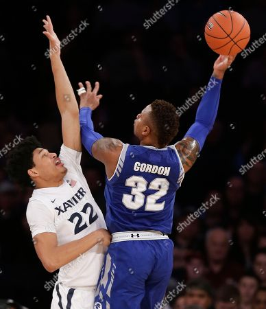 Seton Hall guard Derrick Gordon (32) shoots against Xavier forward Kaiser Gates (22) in the first half of an NCAA college basketball game during the semifinals of the Big East men's tournament, in New York