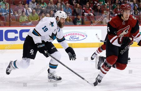 Michael Stone, Joe Thornton San Jose Sharks' Joe Thornton (19) and Arizona Coyotes' Michael Stone, right, race to the puck during the first period of an NHL hockey game, in Glendale, Ariz