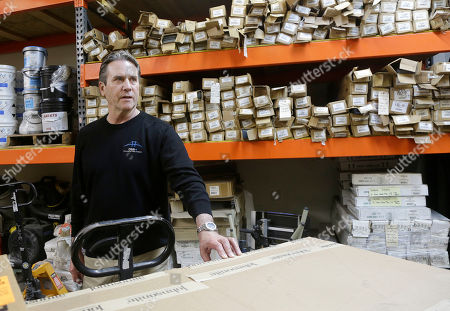 Mike Patton, CEO of DSB Plus flooring company, is interviewed in his warehouses in Milpitas, Calif. As small companies expand their business into more towns, cities and states, that growth often brings higher expenses from taxes and other government obligations