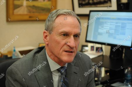 South Dakota Gov. Dennis Daugaard speaks during an interview in his office, in Pierre, S.D. Daugaard's veto of a bill that would have required transgender students to use bathrooms matching their sex at birth wasn't his first break with elements of his Republican Party