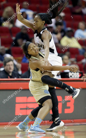 Stock Picture of Danayea Charles, Ashanti Spencer Southern's Danayea Charles, left, and Alabama State's Ashanti Spencer collide during the second half of an NCAA college basketball game in the finals of the Southwestern Athletic Conference tournament, in Houston, Texas. Alabama State won 55-51