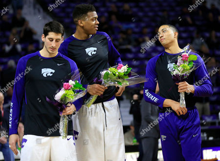 Brian Rohleder, Stephen Hurt, Justin Edwards Kansas State seniors Brian Rohleder, left, Stephen Hurt, middle, and Justin Edwards, right, hold flowers for their parents during a senior day ceremony before the team's NCAA college basketball game against TCU in Manhattan, Kan