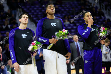 Brian Rohleder, Stephen Hurt, Justin Edwards Kansas State seniors Brian Rohleder, left, Stephen Hurt, middle, and Justin Edwards, right, hold flowers for their parents during a senior day ceremony before an NCAA college basketball game against TCU in Manhattan, Kan