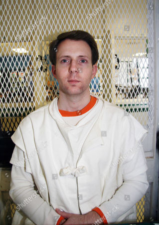 Convicted killer Adam Kelly Ward is photographed Feb. 10, 2016, in a visiting cage outside death row at the Texas Department of Criminal Justice Polunsky Unit near Livingston, Texas. Ward, 33, is set for lethal injection, for fatally shooting code enforcement officer Michael Walker in Commerce, Texas, in 2005 in a trash dispute. Walker was taking pictures of Ward's home, where court documents say rubbish was hoarded inside and outside