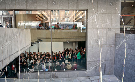 Stock Image of A crowd gathers to listen as Chicago based artist Kerry James Marshall speaks during a press preview of the inaugural exhibition at The Met Breuer museum, in New York. Marshall's work is part of the first exhibition at The Met Breuer, housed in the longtime home of the Whitney Museum of American Art, a 28,000 square foot expansion for The Metropolitan Museum of Art's new series of exhibitions, performances, residencies and artist commissions