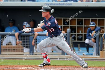 James Beresford Minnesota Twins' James Beresford follows through on a swing against the Tampa Bay Rays during a spring training baseball game, in Port Charlotte, Fla