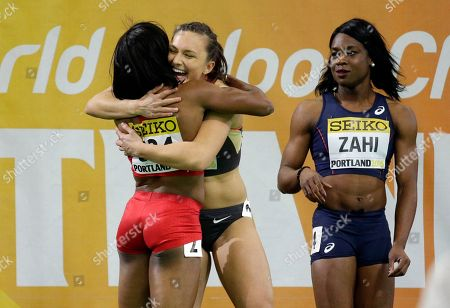 Stock Photo of Barbara Pierre United States' Barbara Pierre, left, is hugged by Germany's Chantal Butzek, center, as France's Carole Zahi, right, looks, after Pierre won a heat of the women's 60-meter sprint during the World Indoor Athletics Championships, in Portland, Ore