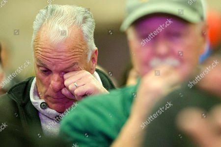 Stock Picture of Air Force veteran Charles Nolan wipes his eye during a ceremony to honor veterans and mark the 50th anniversary of the Vietnam War, in Philadelphia