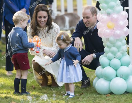 Princess Charlotte, Catherine Duchess of Cambridge, Prince William and Prince George at a children's party for military families, Government House, Victoria, British Columbia