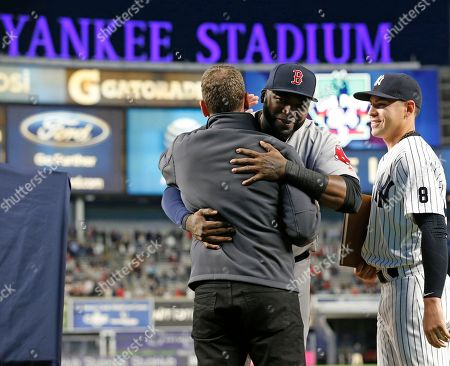 David Ortiz, David Cone, Jacoby Ellsbury Boston Red Sox designated hitter David Ortiz embraces Yankees' broadcaster and former Yankees' pitcher David Cone, as former teammate, Yankees' Jacoby Ellsbury, right, looks on during a pregame ceremony at a baseball game between the Yankees and the Red Sox in New York