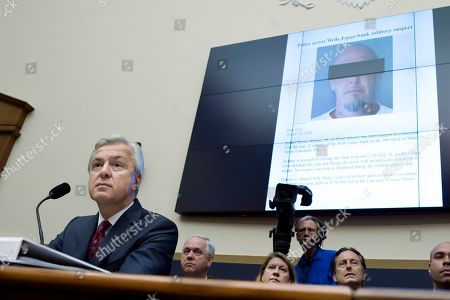 John Stumpf A police press release pertaining to the arrest of Robert Holmes, who was charged with robbing a Wells Fargo Bank in Lancaster, Pa., is projected behind Wells Fargo CEO John Stumpf on Capitol Hill in Washington, as he testifies before the House Financial Services Committee investigating Wells Fargo's opening of unauthorized customer accounts