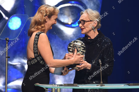 Sian Grigg collects the Sian Phillips Award from Sian Phillips