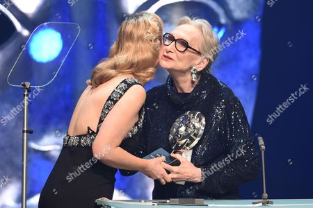 Stock Image of Sian Grigg collects the Sian Phillips Award from Sian Phillips