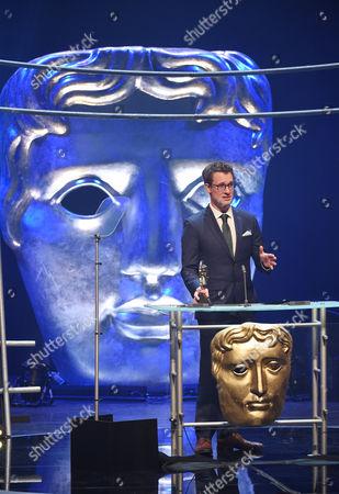 Will Millard collects Presenter award