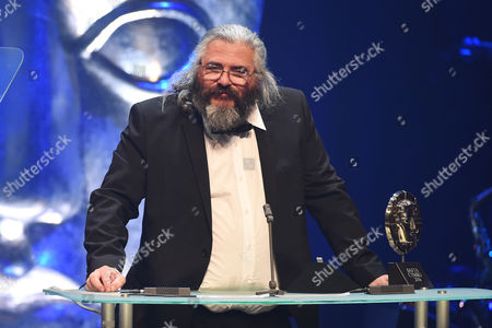 Stock Image of Madoc Roberts collects Editing award for Tim Rhys Evans - All in the Mind