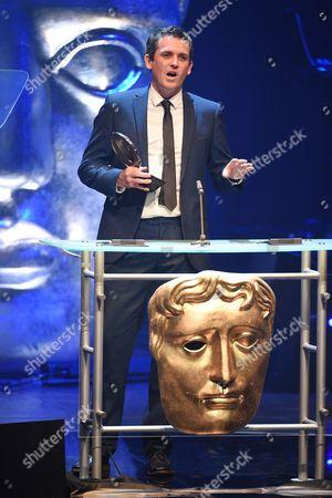 Ed Talfan collects Television Drama award for Hinterland/Y GwyllEd Talfan collects Television Drama award from Gareth David-Lloyd for Hinterland/Y Gwyll
