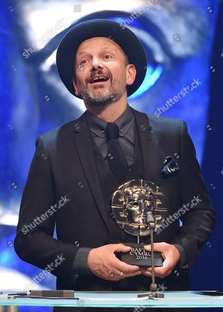 Stock Picture of Tim Dickel collects Production design award for Yr Ymadawiad