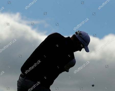 Europe's Chris Woods hits from the 18th tee during a practice round for the Ryder Cup golf tournament, at Hazeltine National Golf Club in Chaska, Minn