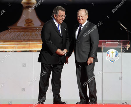 Jack Nicklaus and Tony Jacklin speak during the opening ceremony for the Ryder Cup golf tournament, at Hazeltine National Golf Club in Chaska, Minn