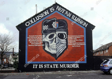 Nationalist Republicans? wall painting, Northern Ireland. ?Collusion is not an illusion, it is state murder. 10 people from Ardoyne were murdered by weapons imported by the British Government from South Africa by their agent Brian Nelson in January 1988 until 1994. The consignment of weapons smuggled in by Nelson...200 AK47 rifles, 90 Browning 9mm pistols, 500 grenades, 30 000 rounds of ammunition, 1 dozen RPG7 rocket launchers and warheads,? on Ardoyne Avenue in Belfast, 2004