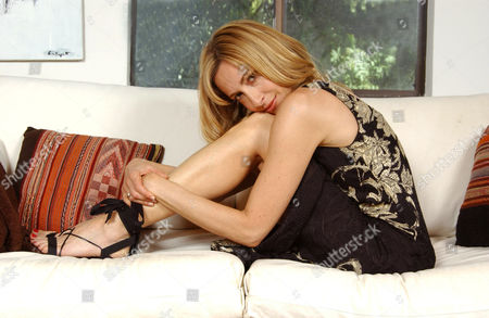 Judi Beecher, the American actress who is a sexy and magical blend of strength and vulnerability with a splash of quirkiness. Judi will be appearing in the new movie 'Danny Love's Angie', that she shot in Dover, New Hampshire. She has just returned from four months in France where she produced, directed and starred in the documentary feature 'Finding Isabelle: A Search For Life After Death', which she is hoping to present at the forthcoming Venice Film Festival, and defiantly at the American Film Festival in Deauville, France. In 2006 we have seen Judi starring in the independent feature, 'Four Weeks, Four Hours'. Judi began her career at the age of three. She produced, directed and starred in basement productions with a cast of cousins and an audience of relatives. At 10 she formed the Beecher Sisters, a singing group with her sister Andrea. They performed at birthday parties in her home town of Great Neck, Long Island. She's modeled in France, Italy and New York. She sang in the south of France next to the Gypsy Kings, and appeared in Cologne and Barcelona as a chanteuse. She's lived around the world and speaks French and Italian fluently and Spanish conversationally. Her first professional acting job in America was with Woody Allen in 'Coop Italia', a string of TV commercials for the Italian market.